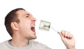 Mens die honderd dollarsrekening eet Royalty-vrije Stock Foto