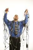 Mens die in kabels wordt verpakt. Royalty-vrije Stock Afbeelding