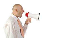 Mens die in megafoon schreeuwt Royalty-vrije Stock Foto's