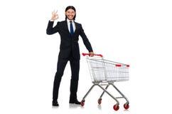 Mens die met de kar van de supermarktmand winkelen Stock Foto's