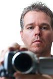 Mens die met een videocamera ontspruit Stock Afbeelding