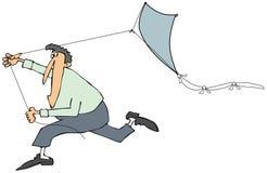 Mens die met een vlieger lopen Stock Foto's