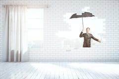 Mens die met paraplu vliegt Royalty-vrije Stock Afbeeldingen