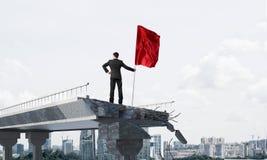 Mens die met vlag leidingsconcept voorstellen Stock Afbeeldingen