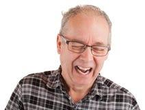 Mens die over iets lachen stock afbeelding