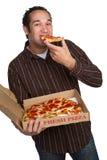 Mens die Pizza eet stock foto