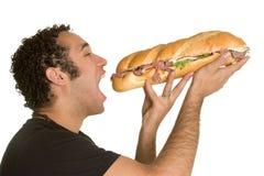 Mens die Sandwich eet Royalty-vrije Stock Afbeeldingen