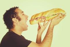 Mens die Sandwich eet royalty-vrije stock foto