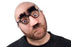 Mens die valse neus draagt Stock Fotografie