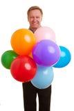 Mens die vele ballons houdt Royalty-vrije Stock Foto's