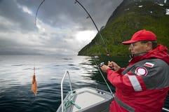 Mens die vissen vangt royalty-vrije stock foto's