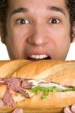 Mens die Voedsel eet royalty-vrije stock afbeeldingen