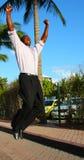 Mens die voor vreugde springt Royalty-vrije Stock Afbeelding