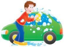 Mens die zijn auto wast Stock Foto's