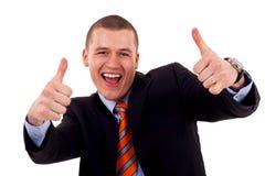 Mens die zijn duimen toont Stock Foto's