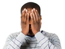 Mens die zijn gezicht behandelt Stock Foto's