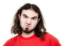 Mens die Zijn Wangen blaast Stock Fotografie
