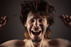 Mens door de actie van elektriciteit wordt geschokt die Stock Afbeeldingen