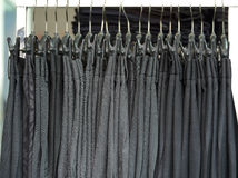 Mens dress pants trousers hanging in shop Royalty Free Stock Image