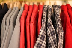 Mens dress shirts. Colorful on hangers Royalty Free Stock Images