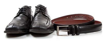Mens' dress shoes and a black belt Royalty Free Stock Photos