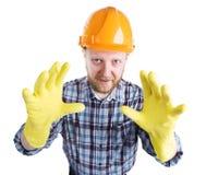 Mens in een helm en gele handschoenen royalty-vrije stock afbeelding