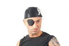 Mens in een piraatkostuum Stock Foto's