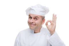 Mens in eenvormige chef-kok Royalty-vrije Stock Afbeeldingen