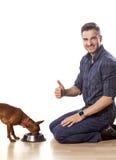 Mens en een hond Stock Foto's