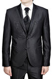 Mens evening black suit, tie knot decorated big pin brooch. Stock Photos