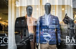 76b63c443ec1 Mens fashion mannequin display. Mens fashion mannequins in store display  with windows glass and street