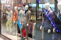 Mens fashion mannequin in store. With windows glass stock image