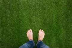 Mens feet standing on grass Stock Photo