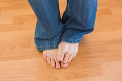 Mens feet on wooden floor Royalty Free Stock Images