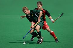 Mens field hockey action Stock Photography