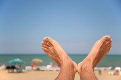 Mens foots closeup. Against a beach stock photography