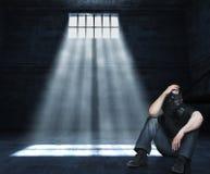 Mens in gevangenis Stock Afbeelding
