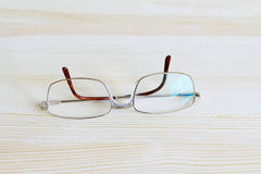 Mens gilded glasses on a table top Royalty Free Stock Photography