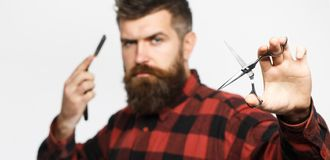 Mens haircut. Barber scissors. Long beard. Bearded man, lush beard, handsome. Vintage barbershop, shaving. Sexy men royalty free stock images