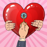 Mens Hand with Key from Womans Heart. Marriage Proposal. Pop Art retro illustration Royalty Free Stock Image