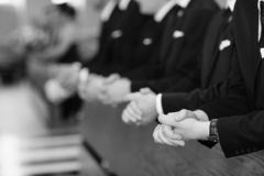 Mens hands in a church royalty free stock photo