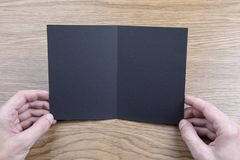 Mens hands holding black booklet stock photos