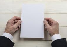 Mens hands holding empty white letterhead stock photos