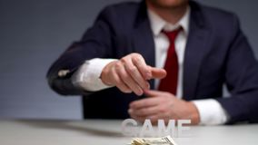 Mens hands holding pack money for stacks to play in game. Bookmaker betting. Mens hands holding pack money for stacks to play in game. Monetary bet on gambling stock footage