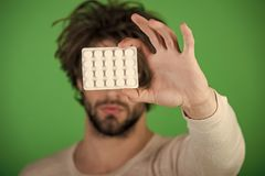 Mens heals care. Man with pills in blister pack. Drug and antidepressant, insomnia. Dieting pill and vitamin, man with anabolic. Health and medicine, hangover Royalty Free Stock Photos