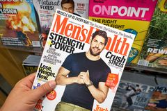 Mens Health magazine in a hand. MIAMI, USA - AUGUST 22, 2018: Mens Health magazine in a hand. Men's Health is a popular magazine published by Rodale Inc royalty free stock photos