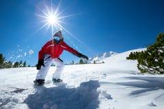 Mens het snowboarding stock afbeelding
