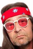 Mens Hoofdband dragen en Rose Colored Glasses die Stock Afbeelding