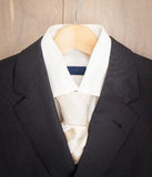 Mens jacket shirt and tie on a hanger Royalty Free Stock Photo