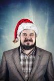 Mens in Kerstmishoed Royalty-vrije Stock Foto's